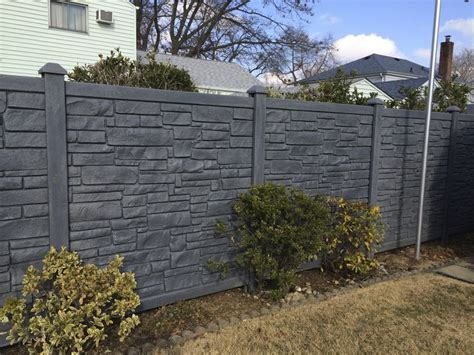 """72"""" black vinyl stone privacy fence installed by Liberty"""